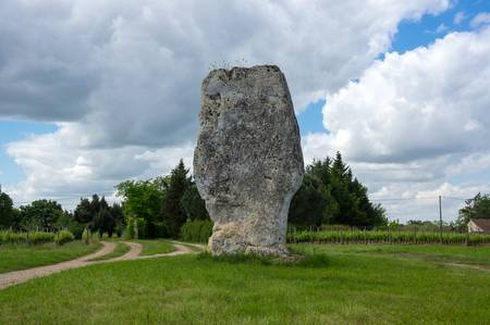 prehistoric: View on prehistoric megalithic menhir in France Stock Photo