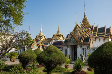 the emerald city: BANGKOK, THAILAND - JANUARY 24, 2015: Unidentified tourists at Wat Phra Kaew in Bangkok, Thailand. Wat Phra Kaew is one of the most popular tourists destination in Thailand.