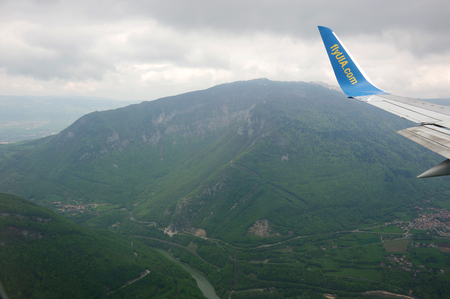 operated: GENEVE AIRPORT, SWITZERLAND ALPES - APRIL 28, 2015: An Aircraft operated by UIA (Ukraine International Airlines), flying between Alpes mountains before landing in Geneve airport