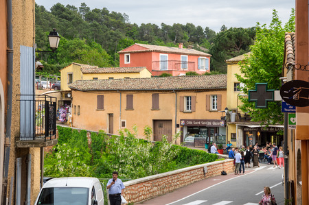 roussillon: ROUSSILLON, FRANCE - MAY 03, 2015: Street of medieval village of Roussillon. It ochre village is included in list of The most beautiful villages of France