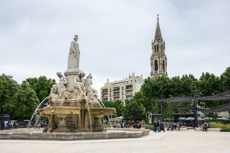 gaulle: NIMES, FRANCE - MAY 04, 2015: Esplanade Charles de Gaulle of Nimes. Nimes is a famous and very popular among tourists city in Provence in south of France