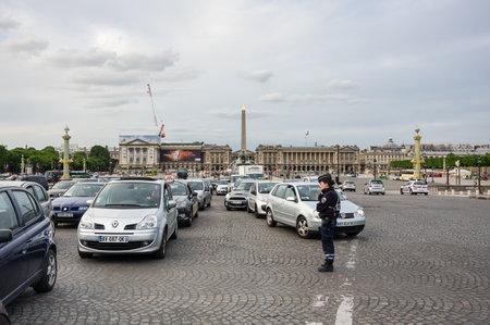 concorde: PARIS, FRANCE - MAY 07, 2015: Traffic on Place de la Concorde in rush hour, Paris, France Editorial