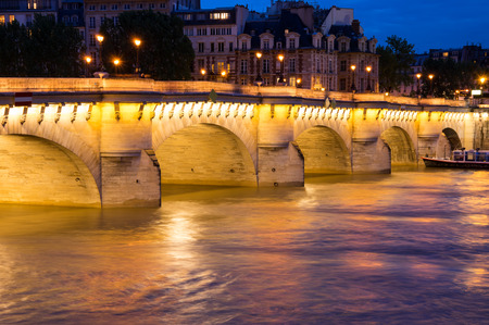 The Pont Neuf (New Bridge) is the oldest standing bridge across the river Seine in Paris, France