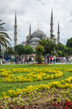 adorning: ISTANBUL, TURKEY - JUNE 19, 2015: Sultan Ahmet Mosque (Turkish: Sultan Ahmet Camii), is a historic mosque in Istanbul, Turkey. The mosque is popularly known as the Blue Mosque for the blue tiles adorning the walls of its interior Editorial