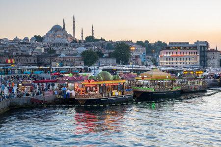 eminonu: ISTANBUL, TURKEY - JUNE 20, 2015: Night view from Galata Bridge towards the Suleymaniye Mosque and fishing boats in Eminonu district, Istanbul, Turkey