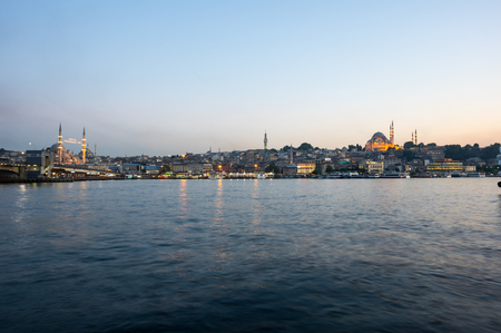 eminonu: ISTANBUL, TURKEY - JUNE 20, 2015: Night view on the Suleymaniye Mosque, New Mosque and fishing boats in Eminonu, Istanbul, Turkey