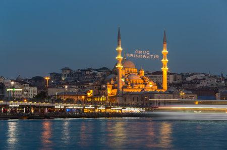 eminonu: ISTANBUL, TURKEY - JUNE 20, 2015: Night view on Galata bridge and  New Mosque in Eminonu, Istanbul, Turkey