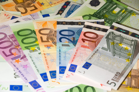 one hundred euro banknote: Scattered euro currency banknotes, closeup view