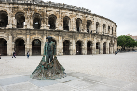 toreador: Statue of Toreador and Ancient Roman Theater (Arena) of Nimes, south of France