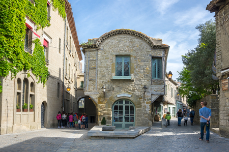 roussillon: CARCASSONNE, FRANCE - MAY 05, 2015: Street with medieval houses in old town of Carcassonne, Languedoc-Roussillon, France