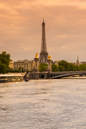PARIS, FRANCE - MAY 07, 2015: Tour Eiffel and Pont Alexandre III bridge over the river Seine in the dusk, Paris, France
