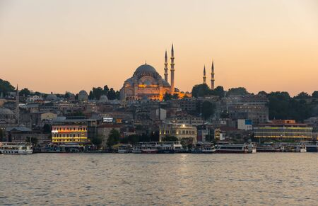 ISTANBUL, TURKEY - JUNE 20, 2015: Night view on the Suleymaniye Mosque and fishing boats in Eminonu, Istanbul, Turkey Editorial