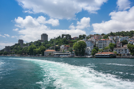separates: ISTANBUL, TURKEY - JUNE 25, 2015: Panoramic view of Istanbul and Bosphorus, which separates Asian Turkey from European Turkey in Istanbul, Turkey