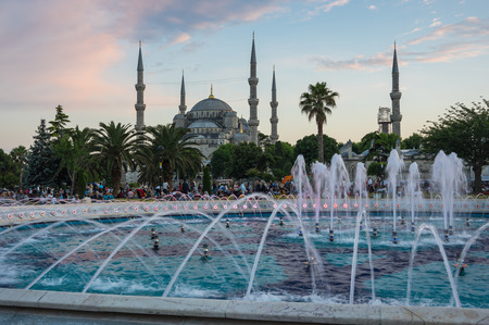 adorning: ISTANBUL, TURKEY - JUNE 25, 2015: Sultan Ahmet Mosque (Turkish: Sultan Ahmet Camii), is a historic mosque in Istanbul, Turkey. The mosque is popularly known as the Blue Mosque for the blue tiles adorning the walls of its interior