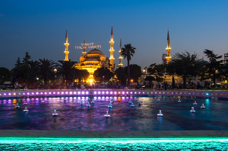 adorning: ISTANBUL, TURKEY - JUNE 25, 2015: Sultan Ahmet Mosque  is a historic mosque in Istanbul, Turkey. The mosque is popularly known as the Blue Mosque for the blue tiles adorning the walls of its interior