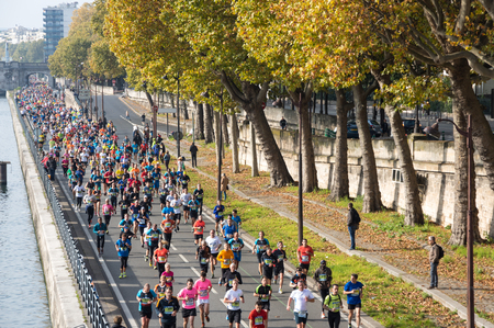 PARIS, FRANCE - OCTOBER 11, 2015: People running marathon in historical center of Paris, France