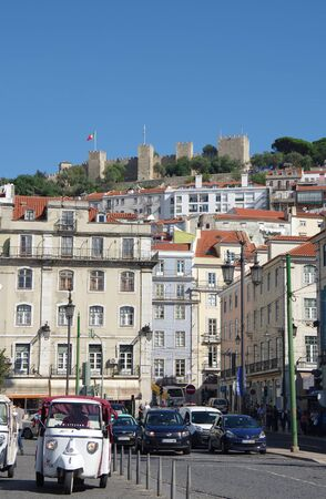 hist: LISBON, PORTUGAL - OCTOBER 14, 2015: Sao Jorge Castle (Saint George Castle) is a Moorish castle occupying a commanding hilltop overlooking the historic centre of Lisbon,Portugal. The strongly fortified citadel dates from medieval period of Portuguese hist