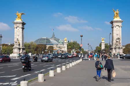 PARIS, FRANCE - OCTOBER 11, 2015: The Pont Alexandre III is a deck arch bridge that spans the Seine in Paris, France. The bridge is widely regarded as the most ornate, extravagant bridge in the city Editorial