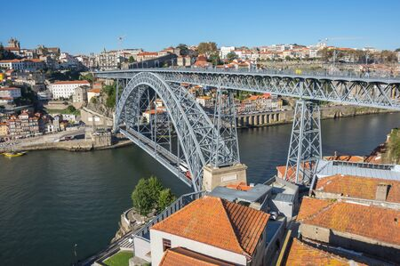 The Dom Luis I Bridge is a double-decked metal arch bridge that spans the Douro River between the cities of Porto and Vila Nova de Gaia in Portugal Stock Photo