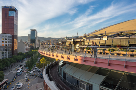 BARCELONA, SPAIN - OCTOBER 23, 2015: People looking at sunset from the roof of Las Arenas - shopping mall in Barcelona, Spain