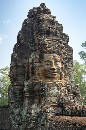Huge carved Buddha face of Bayon temple at Angkor Wat complex, Siem Reap, Cambodia Stock Photo