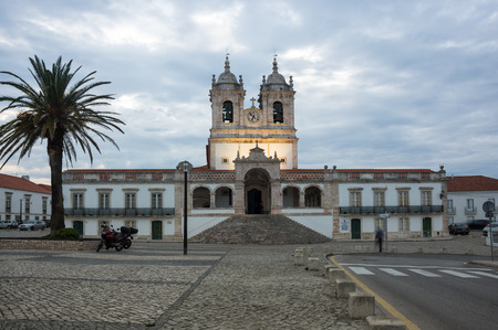 senhora: The Church of Nossa Senhora da Nazare (Church of Our Lady of Nazare) is an imposing church located on the hilltop O Sitio overlooking Nazare, Portugal