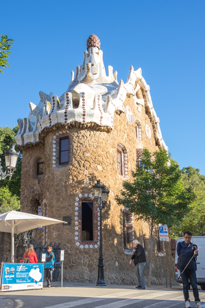 BARCELONA, SPAIN - OCTOBER 23, 2015: The Park Guell is a public park system composed of gardens and architectonic elements located on Carmel Hill, in Barcelona, Catalonia, Spain