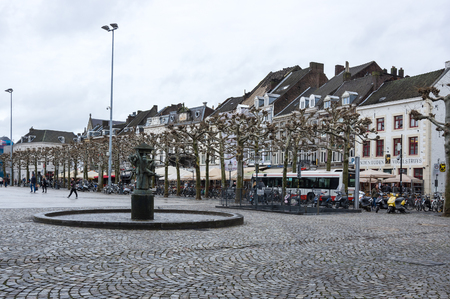 MAASTRICHT, NETHERLANDS - FEBRUARY 20, 2016: Street in the historical center of Maastricht, a city and a municipality in the southeast of the Netherlands