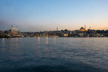ISTANBUL, TURKEY - JUNE 20, 2015: Night view on the Suleymaniye Mosque, New Mosque and fishing boats in Eminonu, Istanbul, Turkey