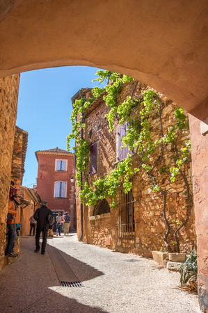 ROUSSILLON, FRANCE - APRIL 27, 2016: Street of medieval village of Roussillon. It ochre village is included in list of The most beautiful villages of France