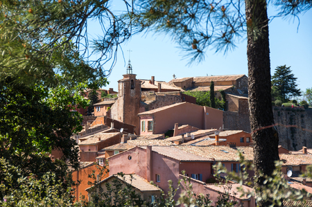 Panoramic view of medieval village of Roussillon. It ochre village is included in list of The most beautiful villages of France