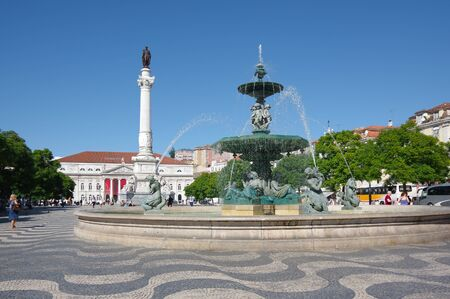 LISBON, PORTUGAL - OCTOBER 14, 2015: Rossio Square is the popular name of the Pedro IV Square in Lisbon, Portugal. It has been one of its main squares since the Middle Ages Editorial