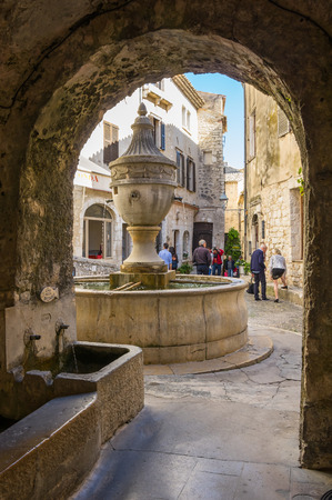 SAINT-PAUL-DE-VENCE, FRANCE - APRIL 25, 2016: Street of Saint-Paul-de-Vence, one of the oldest medieval towns on the French Riviera, well known for its contemporary art museums and galleries, France