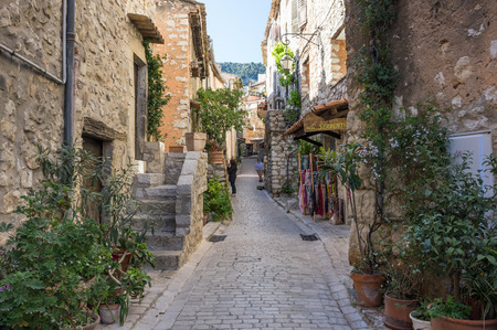 TOURRETTES-SUR-LOUP, FRANCE - APRIL 25, 2016: Street of Tourrettes-sur-Loup, a medieval village in the Alpes-Maritimes department in southeastern France