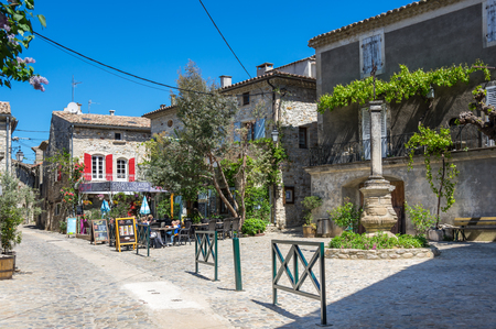 AIGUEZE, FRANCE - APRIL 28, 2016: The street of the village of Aigueze, a small village located south of France in the department of Gard of the french region Languedoc-Roussillon. Editorial