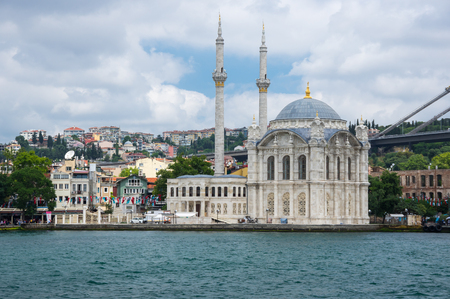 ISTANBUL, TURKEY - JUNE 25, 2015: Ortaköy Mosque (Grand Imperial Mosque of Sultan Abdulmecid) in Istanbul, Turkey, is situated at the waterside of the Ortakoy pier square, one of the most popular locations on the Bosphorus