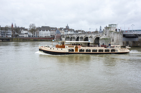 MAASTRICHT, NETHERLANDS - FEBRUARY 20, 2016: Embankment of the Meuse river in the historical center of Maastricht, a city and a municipality in the southeast of the Netherlands