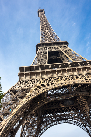 The Eiffel Tower is a wrought iron lattice tower on the Champ de Mars in Paris, France