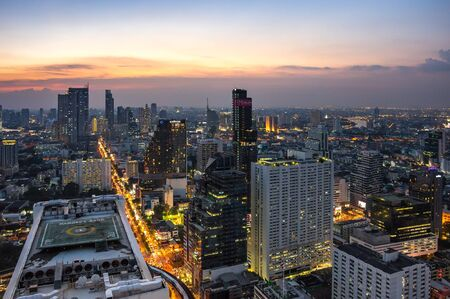 BANGKOK, THAILAND - JANUARY 20, 2017: Top view of skyscrapers in central district of Bangkok on sunset, Bangkok, Thailand