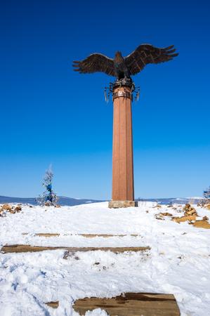 Monument to the eagle - a symbol of shamanism in Tazheran steppe, Irkutsk region, Siberia, Russia