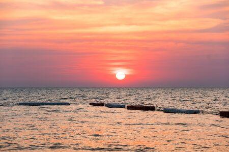 View of sunset over Gulf of Thailand in Pattaya resort, Thailand