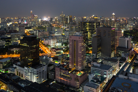 Top view of skyscrapers in central district of Bangkok in the night, Thailand