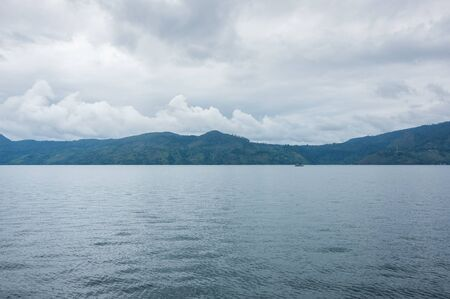 Lake Toba is a large natural lake occupying the caldera of a supervolcano, located in the middle of the northern part of the Indonesian island of Sumatra Banco de Imagens