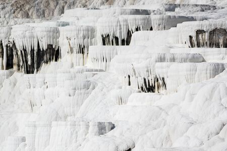The travertines of Pamukkale, formed by calcium-rich mineral water in Denizli, southwestern Turkey Stock Photo