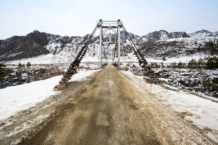 View of the bridge over river Katun in Altay mountains in the winter, Siberia, Russia