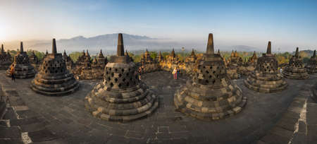 JAVA, INDONESIA - 09 SEPTEMBER 2018: Tourists watching sunrise at Borobudur, a 9th-century Mahayana Buddhist temple in Central Java, Indonesia 新闻类图片