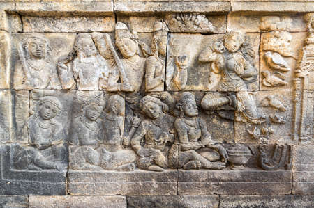 Bas-relief statue at Borobudur, a 9th-century Mahayana Buddhist temple in Central Java, Indonesia. It is the world's largest Buddhist temple. 免版税图像