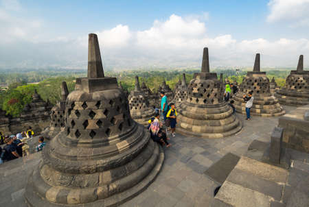 JAVA, INDONESIA - 09 SEPTEMBER 2018: Borobudur is 9th-century Mahayana Buddhist temple in Central Java, Indonesia. The monument is the most visited tourist attraction in Indonesia 免版税图像 - 159484962