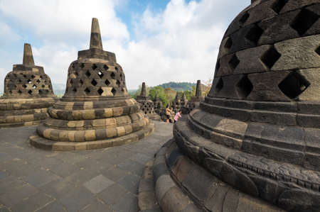 JAVA, INDONESIA - 09 SEPTEMBER 2018: Borobudur is 9th-century Mahayana Buddhist temple in Central Java, Indonesia. The monument is the most visited tourist attraction in Indonesia 免版税图像 - 159484955