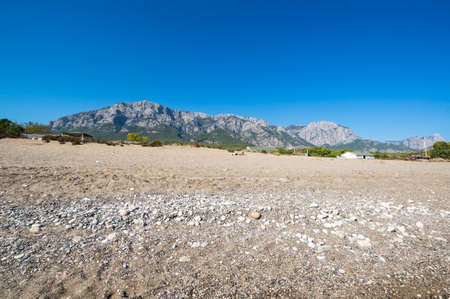 The coast of Mediterranean sea in Kemer, seaside resort and district of Antalya Province on the Mediterranean coast of Turkey Banco de Imagens